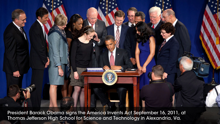 President Barack Obama signs the America Invents Act September 16, 2011, at Thomas Jefferson High School for Science and Technology in Alexandria, Va.